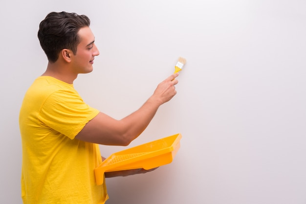 Man painting house in diy concept Premium Photo