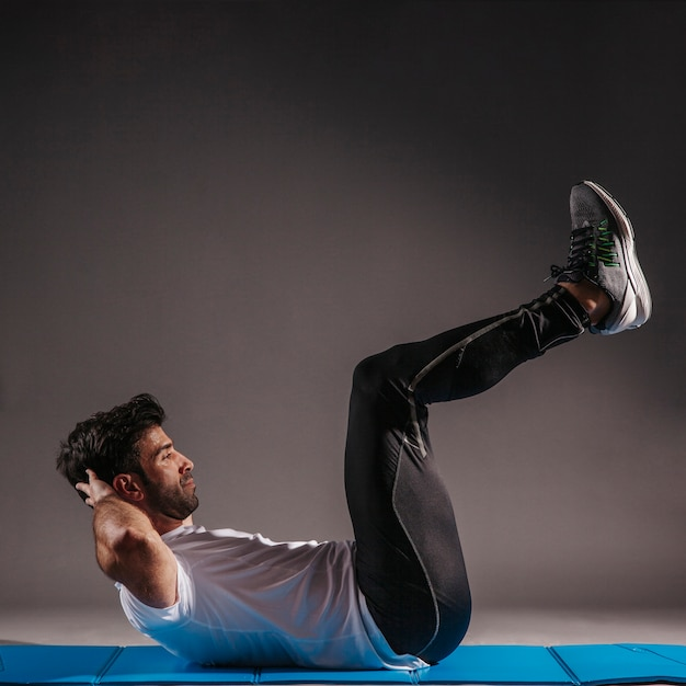 Man performing abdominal crunches Free Photo
