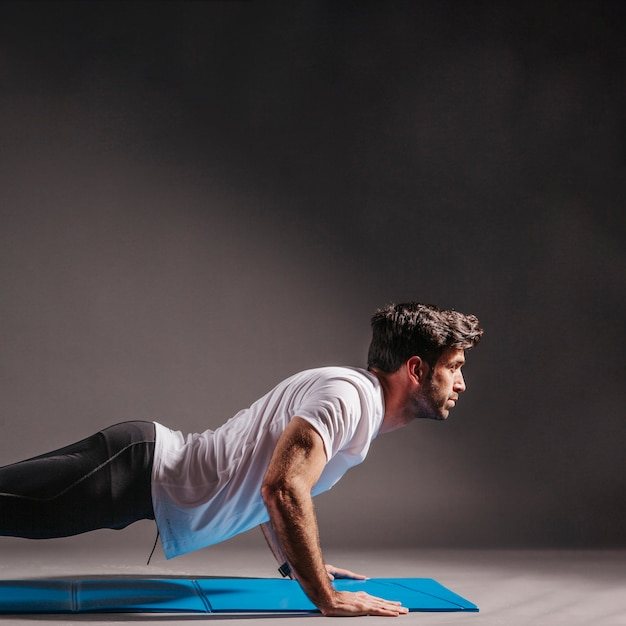 Man performing push-ups Free Photo