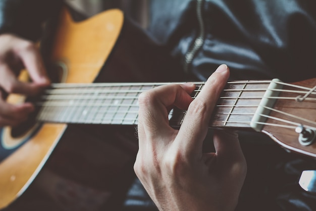 Man playing the guitar Free Photo