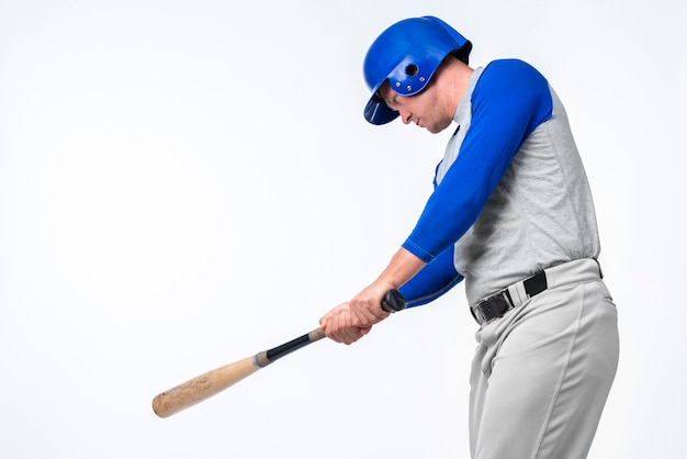 Man playing with baseball bat Free Photo