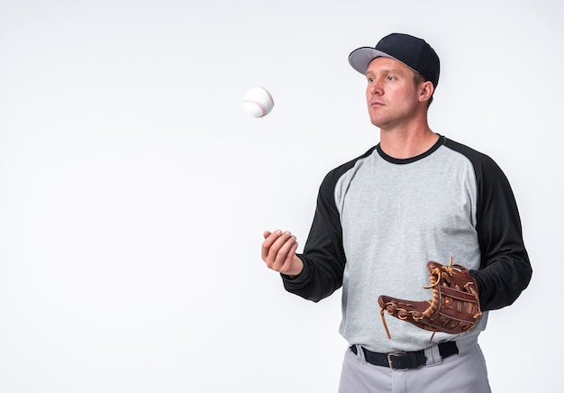 Man playing with baseball and holding glove Free Photo