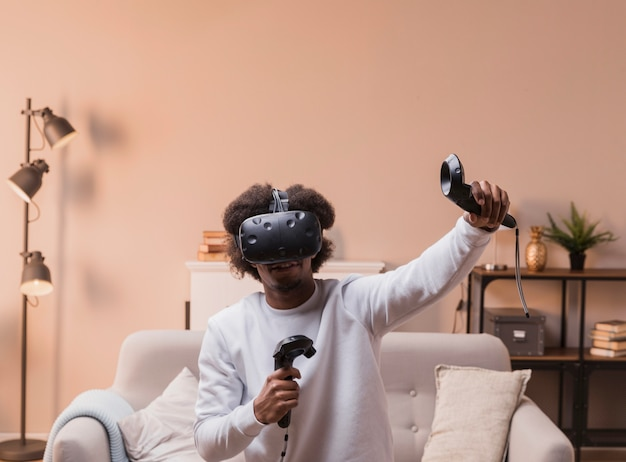 Man playing with virtual headset Free Photo