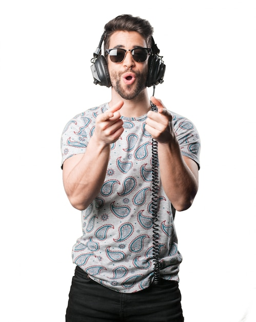 Man pointing with headphones Free Photo