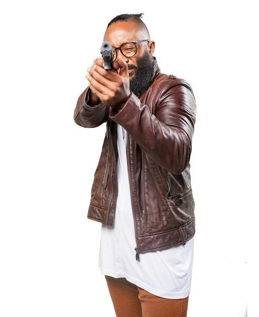 Man pointing with his gun Free Photo
