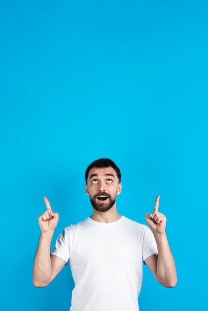 Man posing and pointing up Free Photo