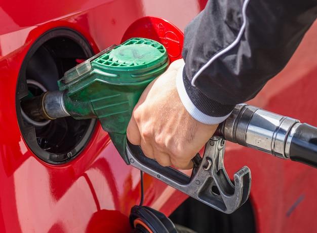 Man pours gasoline into tank of car Premium Photo