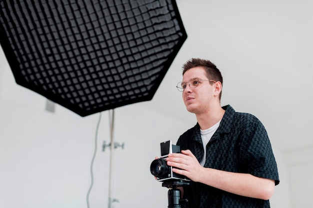 Man preparing the studio for a shooting and looking away Free Photo