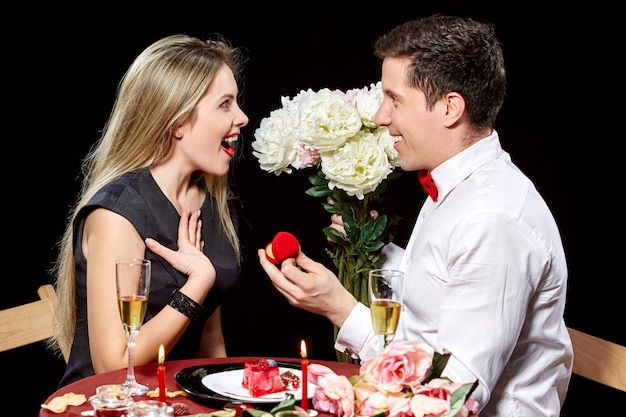 Man proposing marriage to a surprised woman Free Photo