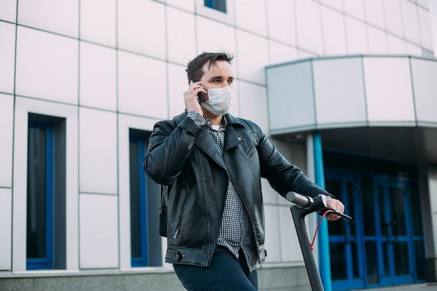 Man in protective mask using mobile phone Premium Photo