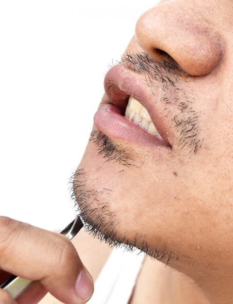 Man pull mustache by tweezers on white background Premium Photo
