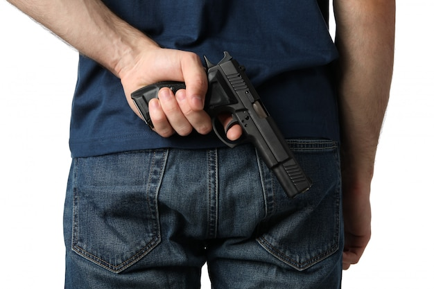 A man pulls a gun from behind, isolated on white Premium Photo