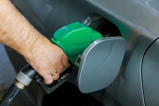 Man pumping gasoline fuel in car transportation at gas station Premium Photo