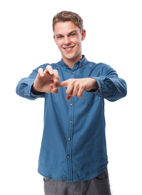 Man putting a finger in his other hand and smiling Free Photo
