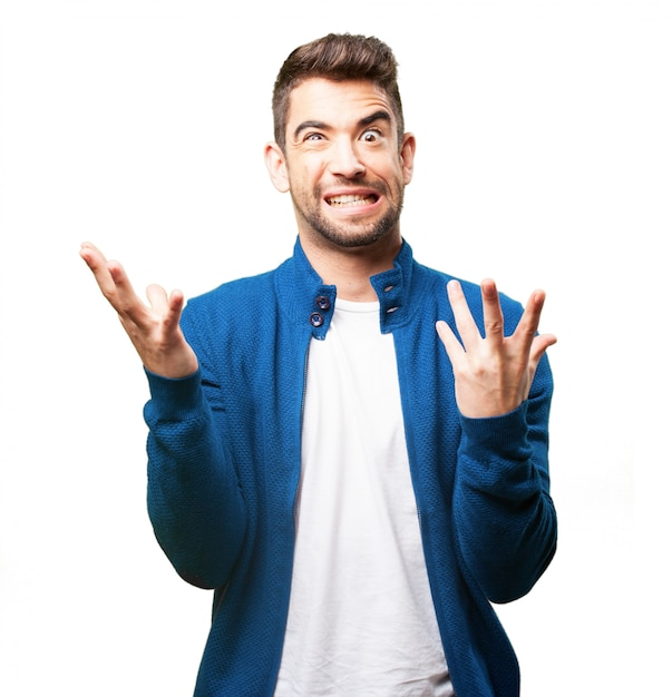 Man putting on a strange face and raised fingers Free Photo