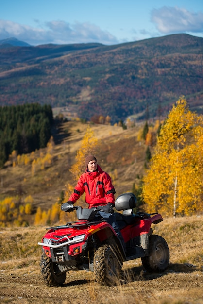 Man on quad bike in the mountains on a blurred background mighty mountains Premium Photo