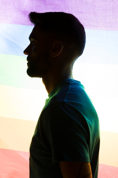 Man on rainbow flag background Free Photo