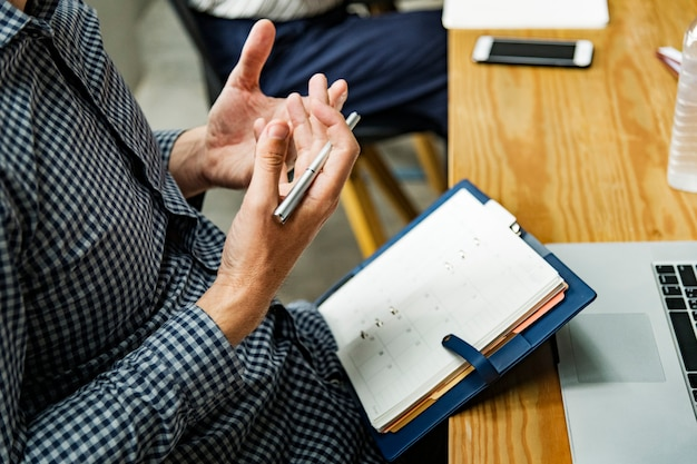Man reading from his agenda Free Photo