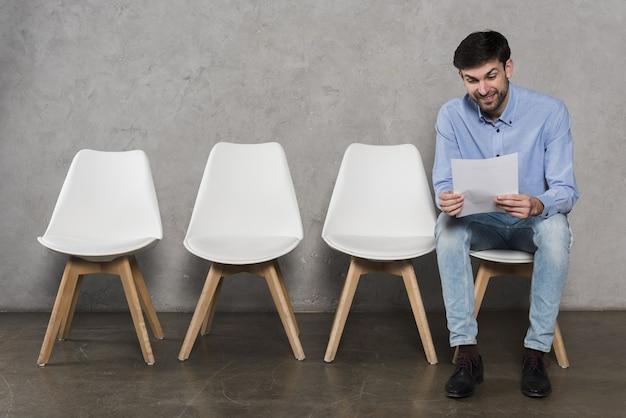 Man reading his resume before having his job interview Premium Photo