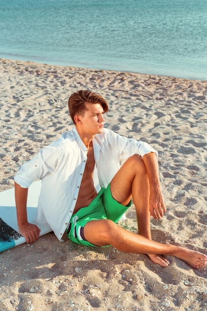 Man relaxing after surfing Premium Photo