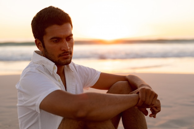Man relaxing on the beach Free Photo