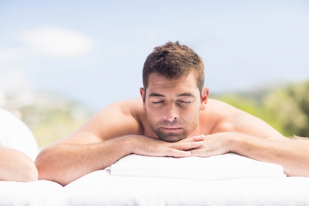 Man relaxing on massage table in spa Premium Photo