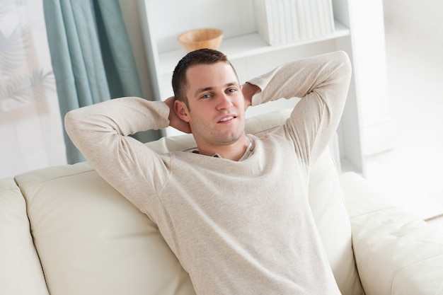 Image result for man relaxing on couch