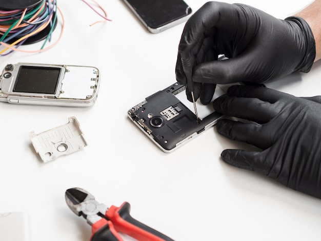 Man removing phone cover for repair Free Photo