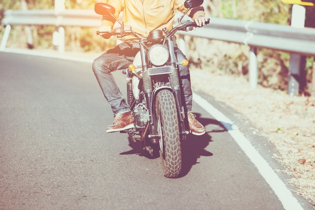 Man riding motorbike on a road in freedom lifestyle at vacation time Premium Photo