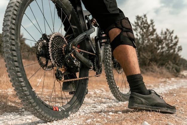 Man riding a mountain bike close-up Free Photo