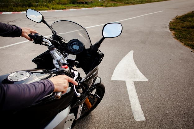 Man riding on the road on the motorbike Free Photo