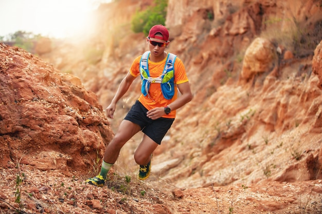 A man runner of trail . and athlete's feet wearing sports shoes for trail running in the mountains Premium Photo