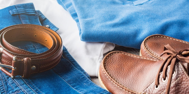 Man's clothes and leather accessories Premium Photo
