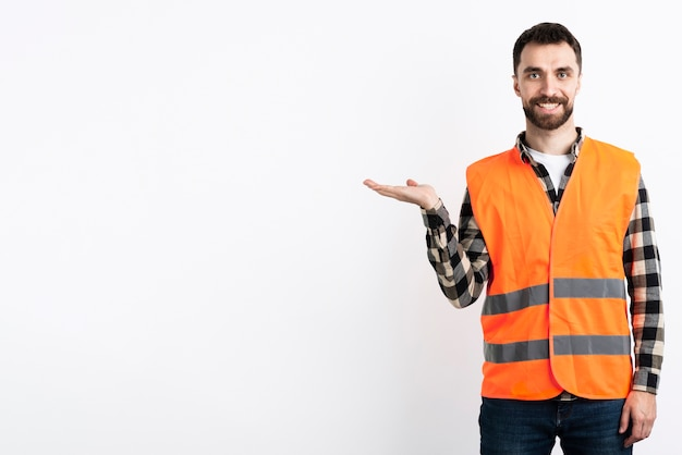 Man in safety vest posing Free Photo