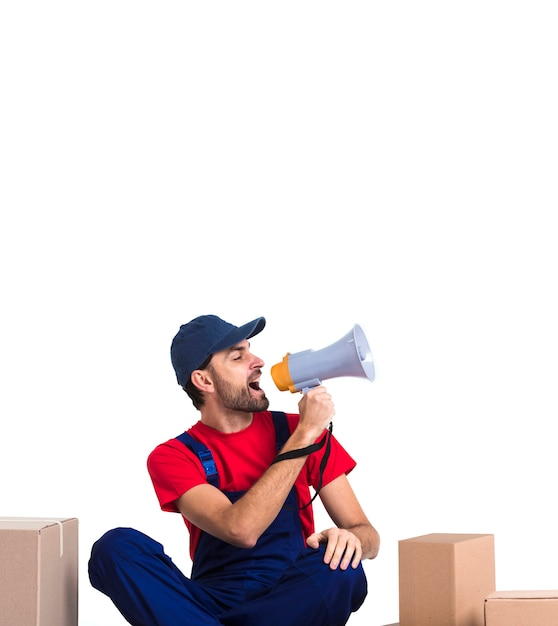 Man screaming in megaphone and holding a box copy space Premium Photo