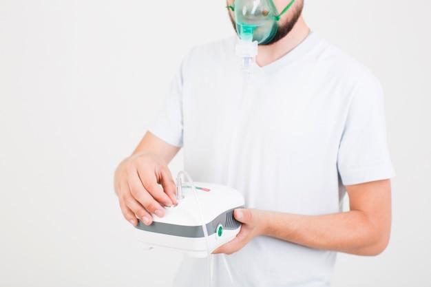 Man setting medical nebulizer Free Photo