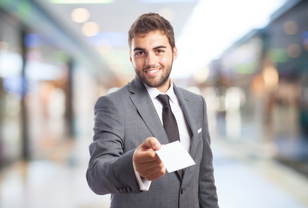 Man in a shopping mall with a paper Free Photo
