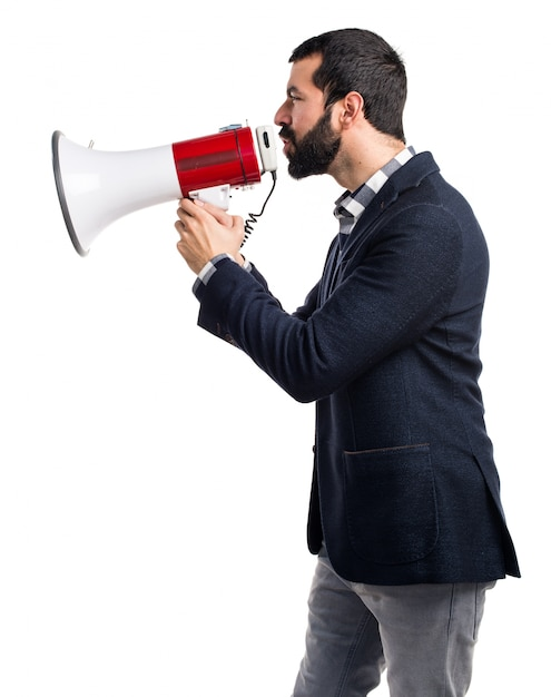Man shouting by megaphone Free Photo