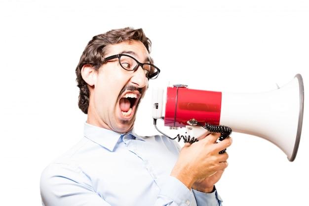 Man shouting through a megaphone Free Photo