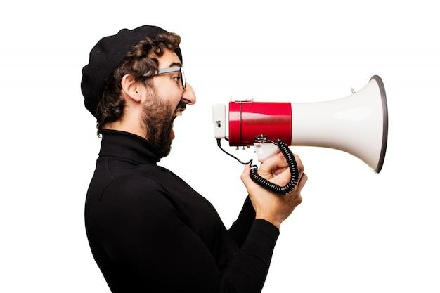 Uomo che grida attraverso un megafono Foto Gratuite