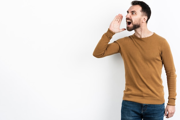 Man shouting while looking away Free Photo