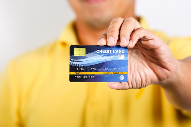 A man showing credit card on white Premium Photo