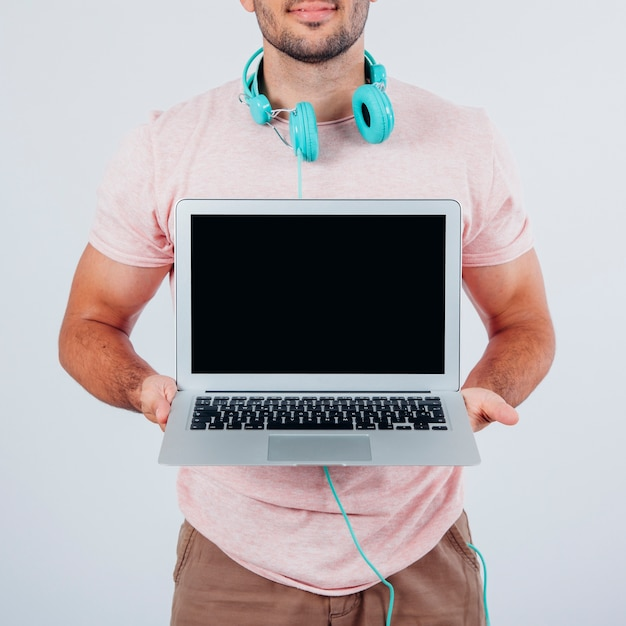 Man showing laptop screen Free Photo
