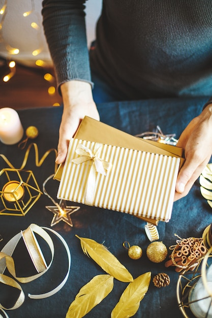 Man showing wrapped gifts Free Photo