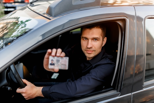 A man shows a driver s license to a policeman. businessman looking at the camera Premium Photo