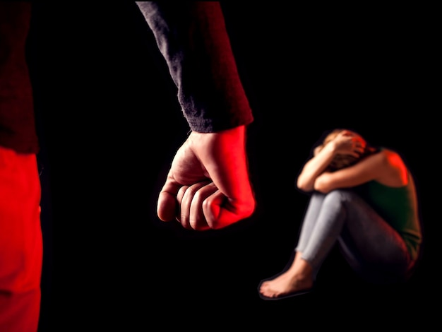 Man shows fist in front of woman. people, family violence, crime concept Premium Photo