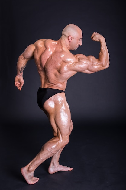 A man shows a pumped body to the camera. Premium Photo