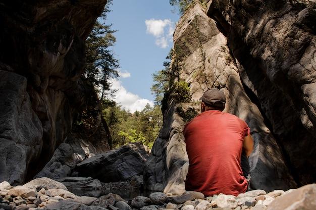 Man sits between cliffs in goynuk canyon Premium Photo