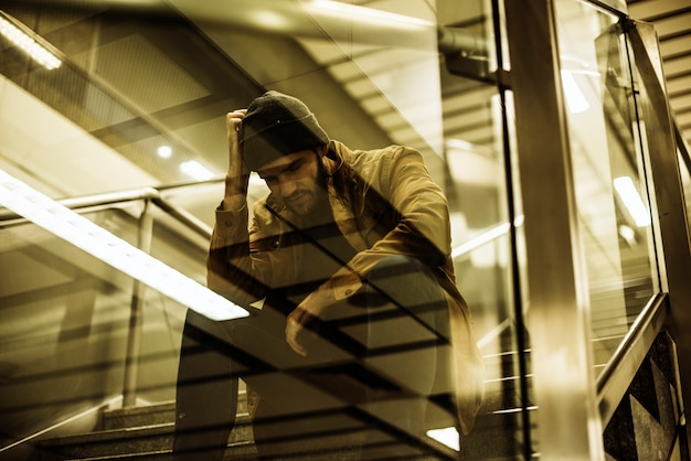 Man sitting look worried on the stairway Premium Photo