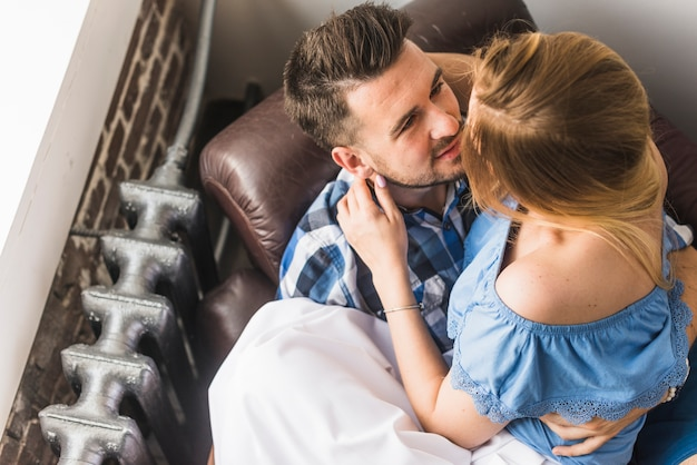 Man sitting on sofa with his girlfriend Free Photo